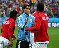 Luis Suarez of Uruguay shakes hands with Liverpool strike partner Daniel Sturridge of England