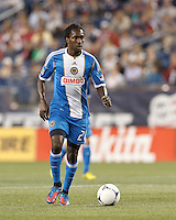 Philadelphia Union substitute midfielder Keon Daniel (26) brings the ball forward. In a Major League Soccer (MLS) match, the New England Revolution tied Philadelphia Union, 0-0, at Gillette Stadium on September 1, 2012.