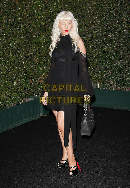 "CHRISTINA AGUILERA .At a private dinner this evening that Louis XIII Black Pearl cognac (SRP $32,000 / bottle) and Christina Aguilera are hosting in honor of photographer Matthew Rolston at the Wallis Annenberg Cultural Center . The event will celebrate the debut of Matthew Rolston?s new book called ""beautyLIGHT""  in Beverly Hills, California, USA..November 10th, 2008.full length black dress sheer sleeves off the shoulder bag purse christian louboutin shoes heels mary janes platform lace .CAP/DVS.©Debbie VanStory/Capital Pictures."