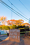 "November 6, 2012 - Merrick, New York, U.S. -  Major property damage and power outages remain over a week after Hurricane Sandy devastated the south shore of Long Island. At Merrick home, a handmade sign in road warns ""CAUTION LIVE WIRE!"" and a raw wood sign on front yard of the corner home announces ""I NEED ESTIMATES."""