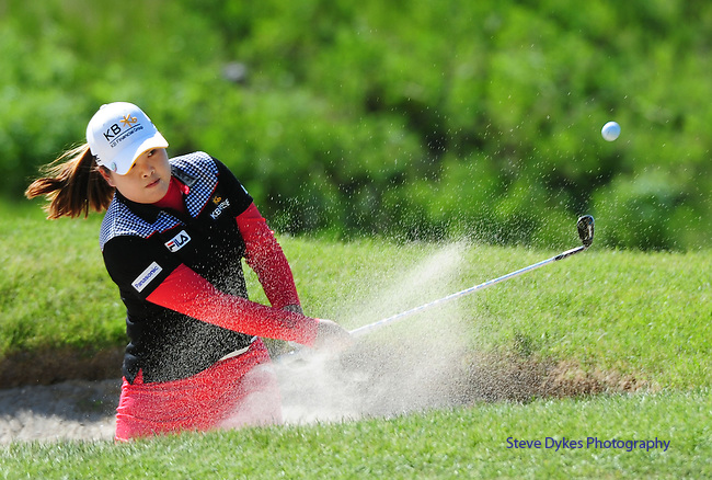 WATERLOO, ON. - JUNE 6: Inbee Park, of South Korea, hits out of a bunker on the fifth hole during the second round of the Manulife Financial LPGA Classic at the Grey Silo Golf Course on June 6, 2014 in Waterloo, Ontario, Canada.. (Photo by Steve Dykes/Getty Images) *** Local Caption *** Inbee Park