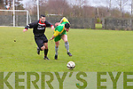 Kerry's John McDonagh get away from UCL's David Hempentall in the match of Kerry against  UCL Dublin in Oscar Trynor Cup quarter final at Mounthawk park on Sunday