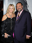 "HOLLYWOOD, CA. - November 19: Joel Silver (R) and wife Karyn Fields arrive at the ""Ninja Assassin"" Los Angeles Premiere at the Grauman's Chinese Theatre on November 19, 2009 in Hollywood, California."
