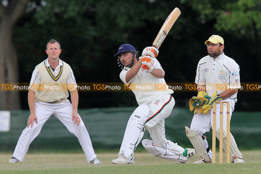 G Bhogal in batting action for Ilford as R Smith and F Butt look on - Ilford CC (batting) vs Ardleigh Green CC - Essex Club Cricket at Valentines Park - 14/05/11 - MANDATORY CREDIT: Gavin Ellis/TGSPHOTO - Self billing applies where appropriate - Tel: 0845 094 6026