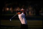 Tiger Woods watches his fairway shot at the Genuity Open at Doral in Miami, Fl.
