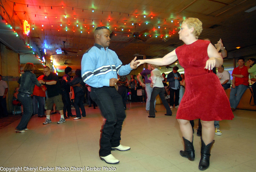 A couple dances to the music of Geno Delafose and French Rockin' Boogie at the Mid-City Rock 'n Bowl in New Orleans, Thursday, April 26, 2007..