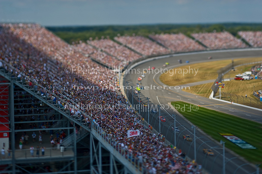 15-17 August 2008, Brooklyn, Michigan.The field follows the pace car through turn 4. (Note:Image was taken using a tilt/shift lens).©F.Peirce Williams 2008.F. Peirce Williams.photography