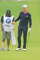 Mikko Ilonen (FIN) and caddy Reggie on the 17th green during Saturay's Round 3 of the 2014 BMW Masters held at Lake Malaren, Shanghai, China. 1st November 2014.<br /> Picture: Eoin Clarke www.golffile.ie