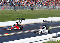 May 21, 2017; Topeka, KS, USA; NHRA top fuel driver Antron Brown (right) defeats Kebin Kinsley during the Heartland Nationals at Heartland Park Topeka. Mandatory Credit: Mark J. Rebilas-USA TODAY Sports