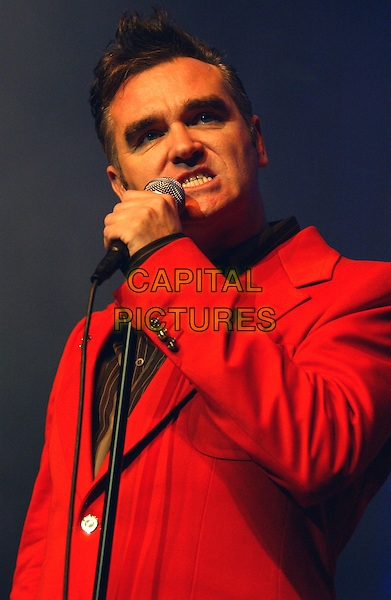"""MORRISSEY.Morrissey performs live to a sold out crowd to promote his upcoming album """"You are the Quarry"""" The show was the first of his Southern California performances, at The Grove of Anaheim,.18th April 2004.half length half-length concert gig on stage singing music red jacket funny face.*UK sales only*.www.capitalpictures.com.sales@capitalpictures.com.©Capital Pictures"""