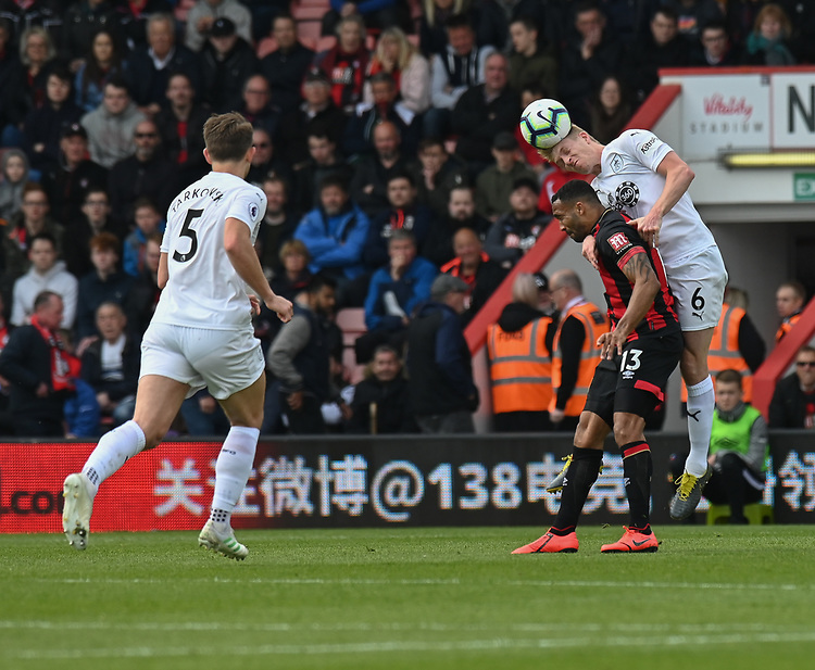 Burnley's Ben Mee (right) battles with Bournemouth's Callum Wilson (left) <br /> <br /> Photographer David Horton/CameraSport<br /> <br /> The Premier League - Bournemouth v Burnley - Saturday 6th April 2019 - Vitality Stadium - Bournemouth<br /> <br /> World Copyright © 2019 CameraSport. All rights reserved. 43 Linden Ave. Countesthorpe. Leicester. England. LE8 5PG - Tel: +44 (0) 116 277 4147 - admin@camerasport.com - www.camerasport.com