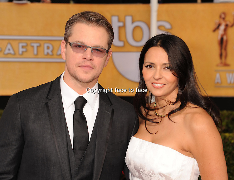 LOS ANGELES, CA- JANUARY 18: Actor Matt Damon and wife Luciana Barroso arrive at the 20th Annual Screen Actors Guild Awards at The Shrine Auditorium on January 18, 2014 in Los Angeles, California.<br />
