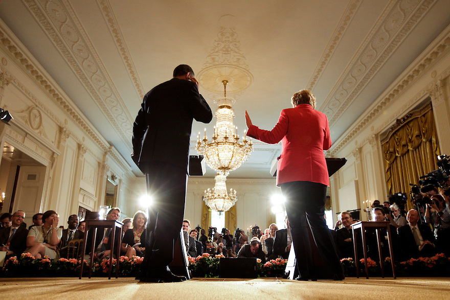 President Barack Obama and German Chancellor Angela Merkel participate in a joint news conference in the East Room of the White House in Washington...Photo by Brooks Kraft/Corbis............