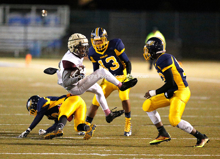 Waterbury, CT- 04 November 2016-110416CM15-   Sacred Heart's Courie Stevenson gets spun around after a catch during their NVL matchup against Kennedy in Waterbury on Friday.  Defending are Kennedy's Tyvon Stenson, left, Marquise Blagmon (13) and Rhakeem Henry, right.   Christopher Massa Republican-American