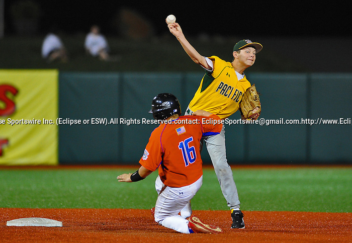 Longview(WA)'s Zachary Brown tries to turn a double play during the All Star Game at the Cal Ripken Babe Ruth World Series in Aberdeen, Maryland on August 16, 2012 featuring Team Bambino and Team Ironman comprised of players from all the teams that did not advance to the playoffs. Team Ironman (Longview(WA), Newtown(CT), Little Rock(AR) and Canada) defeated Team Bambino (Mattoon(IL), Lamar(CO), Harford County and Australia) 4 to 3.