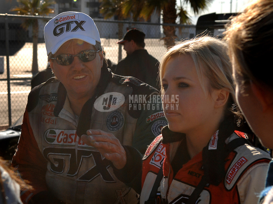 "Jan 20, 2007; Las Vegas, NV, USA; NHRA Super Comp driver Brittany Force receives instructions from her father John Force during preseason testing at ""The Strip"" at Las Vegas Motor Speedway in Las Vegas, NV. Mandatory Credit: Mark J. Rebilas"