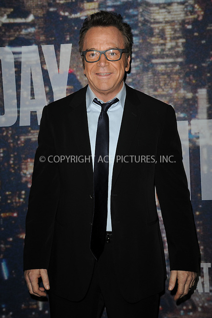 WWW.ACEPIXS.COM<br /> February 15, 2015 New York City<br /> <br /> Tom Arnold walking the red carpet at the SNL 40th Anniversary Special at 30 Rockefeller Plaza on February 15, 2015 in New York City.<br /> <br /> Please byline: Kristin Callahan/AcePictures<br /> <br /> ACEPIXS.COM<br /> <br /> Tel: (646) 769 0430<br /> e-mail: info@acepixs.com<br /> web: http://www.acepixs.com