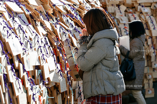 Students pray for success in school entrance exams at Yushima Tenjin Shrine on January 12, 2017, Tokyo, Japan. Nestle's Kit Kat product is popular with students because its pronunciation in Japanese sounds like ''Kitto Katsu'' which means ''surely win''. Every year Japanese students tie hand-written wishes and messages at the shrine, wishing for luck in passing entrance exams to high school and colleges. The Yushima Tenjin Shrine is dedicated to the god of learning. (Photo by Rodrigo Reyes Marin/AFLO)