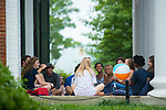 Orientation leader Caroline Goss, left, has her small group get to know each other on the porch of the Lyceum. Photo by Kevin Bain/University Communications Photography.