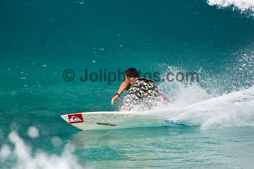 MICHEL BOUREZ (PYF) surfing at Off The Wall-Backdoor, North Shore of Oahu, Hawaii. Photo: joliphotos.com