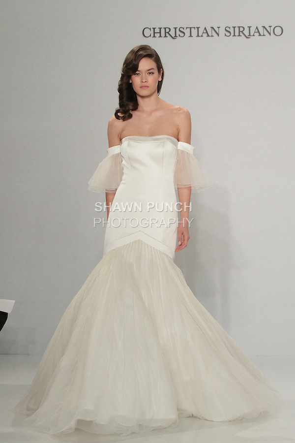 Model walks runway in an embroidered off-the-shoulder gown, from the Christian Siriano for Kleinfeld bridal collection, at Kleinfeld on April 18, 2016 during New York Bridal Fashion Week Spring Summer 2017.