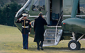 United States President Barack Obama salutes the Marine Guard as he prepares to board Marine One to depart the White House in Washington, DC on January 20, 2016. The President is traveling to Detroit, Michigan to visit the 2016 North American International Auto Show. <br /> Credit: Olivier Douliery / Pool via CNP