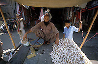 Pakistan  Peshawar  1986..Old City..A stand of garlic