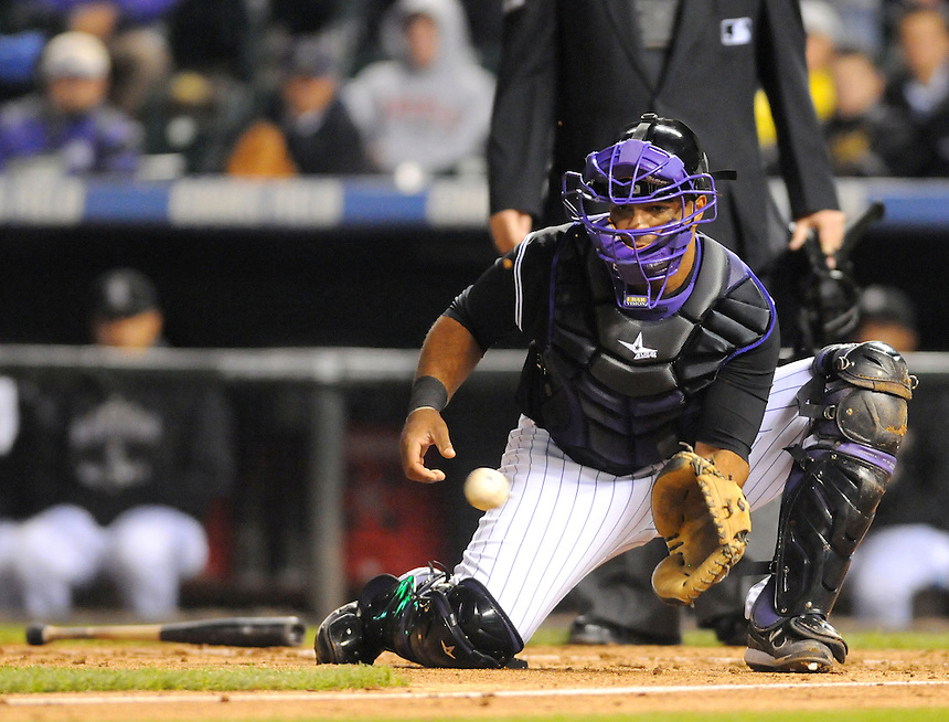 07 SEPTEMBER 2011:  Rockies catcher Wilin Rosario (12)  during a regular season game between the Arizona Diamondbacks and and the Colorado Rockies at Coors Field in Denver, Colorado.  The Diamondbacks beat the Rockies 5-3.  *****For Editorial Use Only*****