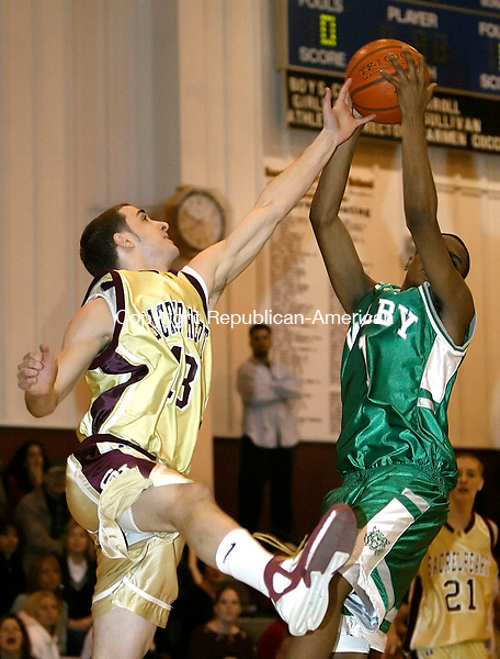 WATERBURY, CT. 23 FEBRUARY 2006- 022306BZ06-  Sacred Heart's Tim Bamote (13) fights for the rebound with Wilby's Jamarus Mathews (1)<br /> during their game at Sacred Heart Thursday night<br /> Jamison C. Bazinet / Republican-American
