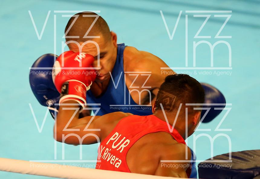 BARRANQUILLA - COLOMBIA, 25-07-2018: RIVERA FIGUEROA Yankiel (Puerto Rico) vs JIMENEZ RODRIGUEZ David A. (Costa Rica) durante su participación en boxeo masculino categoría mosca como parte de los Juegos Centroamericanos y del Caribe Barranquilla 2018. /  RIVERA FIGUEROA Yankiel (Puerto Rico) vs JIMENEZ RODRIGUEZ David A. (Costa Rica) during their participation in the boxing men's fly category of the Central American and Caribbean Sports Games Barranquilla 2018. Photo: VizzorImage / Cont