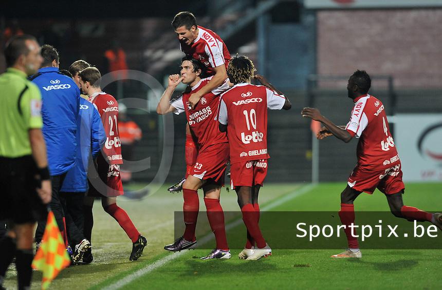 Sporting Lokeren - KV Kortrijk : Ervin Zukanovic scoort de 0-2 voor Kortrijk en viert dit met de op zijn rug springende Rami Gershon .foto VDB / BART VANDENBROUCKE