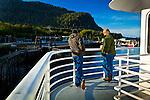 Passengers on Kennicott Ferry, Alaska Marine Highway System, leaving Prince Rupert, B.C. to Alaska's Inside Passage in the morning, early summer.