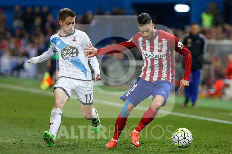 Atletico de Madrid´s Carrasco and Deportivo de la Coruna´s Cartaglia during 2015-16 La Liga match between Atletico de Madrid and Deportivo de la Coruna at Vicente Calderon stadium in Madrid, Spain. March 12, 2016. (ALTERPHOTOS/Victor Blanco)