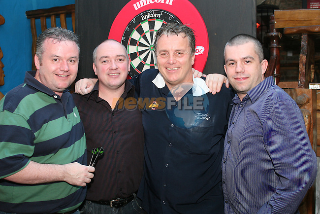 Matthews, Kearney and O'Brien from Castlebellingham meet Keith Deller at the World Darts Exhibition in Shooters...Photo NEWSFILE/Jenny Matthews.(Photo credit should read Jenny Matthews/NEWSFILE)....This Picture has been sent you under the condtions enclosed by:.Newsfile Ltd..The Studio,.Millmount Abbey,.Drogheda,.Co Meath..Ireland..Tel: +353(0)41-9871240.Fax: +353(0)41-9871260.GSM: +353(0)86-2500958.email: pictures@newsfile.ie.www.newsfile.ie.FTP: 193.120.102.198.