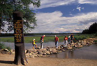 AJ2882, Mississippi River, headwaters, Itasca Park, Minnesota, People walking across the Mississippi River on rocks at the headwaters of the river in Itasca State Park in the state of Minnesota.