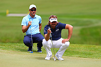 Victor Dubuisson and Florian Fritsch on the 4th green during the BMW PGA Golf Championship at Wentworth Golf Course, Wentworth Drive, Virginia Water, England on 28 May 2017. Photo by Steve McCarthy/PRiME Media Images.