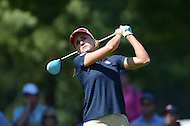 Owings Mills, MD - July 26, 2014: Lexi Thompson, of Team USA, tees off on the 10th hole during Round 3 of four-ball competition at the LPGA International Crown at the Caves Valley Golf Club in Owings Mills, MD on July 26, 2014. 32 players from twelve countries competed in this inaugural tournament.  (Photo by Don Baxter/Media Images International)
