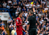 Trent Alexander-Arnold of Liverpool receives a yellow card from Referee Michael Oliver during the Premier League match between Chelsea and Liverpool at Stamford Bridge, London, England on 22 September 2019. Photo by Liam McAvoy / PRiME Media Images.