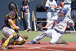 Reno's Ryan Boucher is safe at home as Galena catcher Nico Pezonella attempts the tag in the NIAA Division I Northern Region Baseball Championship between the Galena Grizzlies and the Reno Huskies played on Saturday, May 14, 2016 at Peccole Park in Reno, Nevada.