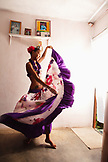 MAURITIUS, Surinam, a young woman Sega dancer, Cyndia Venratachullum, dances in her home to the rhythm of the Sega music
