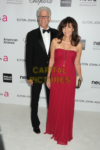 Ted Danson, Mary Steenburgen.20th Annual Elton John Academy Awards Viewing Party held at West Hollywood Park, West Hollywood, California, USA..February 26th, 2012.full length tuxedo red dress strapless married husband wife glasses .CAP/ADM/BP.©Byron Purvis/AdMedia/Capital Pictures.
