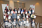"""HANDWRITING: Children from schools around Kerry who were winners in the INTO/EBS Hand writing competition  who were presented with their certificates and awards at a special cermoney  in the Carlton Hotel Tral;ee on Tuesday evening, Tom Stuart (manager of EBS Tralee) who presented the certificate and Awards with Meabh Coleman (INTO) and helping out were staff of the EBS TRalee, Caroline Quilter,Michelle Scanlon, Muiris Horgan, Ivan Stuart, Patricia Cronin and Aoife O'Sullivan. Children, Section A Junior infants Jack Mc tSithigh (1st ) Bunscoil an Chlochair An Daingean, Eddie Óg Scully (2nd,Knocknaderry NS,Farranfore) and 3rd in the Section A Junior Infants ewas Nicole Mileusnic (Kilcummin NS).Section """"C"""" 1st  and 2nd Class, Darragh Hudson 1st class Dromclough NS Listowel,and 2nd class  Meabh Coleman (Knocknaderry NS. Section """"D"""" 3rd and 4th Class, Eabha Murphy (Spa NS 1st) katarzna Kiorek (St Teresa's Kilflynn 2nd), Ciara Rohan (St Teresa's Kilflynn 3rd) and special award Amy harrington (St John's NS Kenmare), section """"E"""" 5th and 6th class, Abbie Daly Scoil Dar Earea, Valentia 1st),  Ciara Keane """"2""""nd Scoil Mhuire Gan Smal, Lixnaw), Brian O'Leary (""""3"""" rd) Knocknaderry NS Farranfore, section """"F"""" Certificate Achievement, Jack O'Connor , Scoil Mhuire Lissivigeen,Linus Og Burke, Nagle Rice NS Miltown and Leah Hickey St Teresa's Kilflynn, Section """"G"""" Certificate of Achievement, Cillian O'Donoghue,Kilcummin NS, Shauna Allen,Scoil Mhuire,Lissivigeen and Gabrille Coffee,nagle Rice NS, Miltown."""