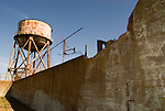 The water tower rises above the recreation yard at Alcatraz prison in San Francisco Bay, San Francisco, California.