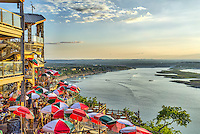 This is another image of the Oasis on Lake Travis is a popular eating and drinking spot sitting above the water and a great place to catch a sunset while sipping on a drink and eating a nice dinner.  I do miss their more colorful umbrella we had hoped to see the brightly colored umbrellas, but they have been replace, darn.