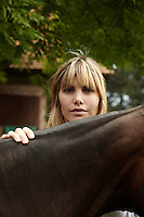 Delfina Figueras with one of the horses in the stableyard