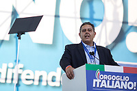 """Giovanni Toti (Leader of Cambiamo - Giovanni Toti Presidente, President of Liguria Region). <br /> <br /> Rome, 19/10/2019. Today, tens thousands of people (200,000 for the organisers, 50,000 for the police) gathered in Piazza San Giovanni to attend the national demonstration """"Orgoglio Italiano"""" (Italian Pride) of the far-right party Lega (League) of Matteo Salvini. The demonstration was supported by Silvio Berlusconi's party Forza Italia and Giorgia Meloni's party Fratelli d'Italia (Brothers of Italy, right-wing).  <br /> The aim of the rally was to protest against the Italian coalition Government (AKA Governo Conte II, Conte's Second Government, Governo Giallo-Rosso, 1.) lead by Professor Giuseppe Conte. The 66th Government of Italy is a coalition between Five Star Movement (M5S, 2.), Democratic Party (PD – Center Left, 3.), and Liberi e Uguali (LeU – Left, 4.), these last two parties replaced Lega / League as new members of a coalition based on Parliamentarian majority as stated in the Italian Constitution. The Governo Conte I (Conte's First Government, 5.) was 14-month-old when, between 8 and 9 of August 2019, collapsed after the Interior Minister Matteo Salvini withdrew his euroskeptic, anti-migrant, right-wing Lega / League (6.) from the populist coalition in a pindaric attempt (miserably failed) to trigger a snap election.<br /> <br /> Footnotes & Links:<br /> 1. http://bit.do/feK6N<br /> 2. http://bit.do/e7JLx<br /> 3. http://bit.do/e7JKy<br /> 4. http://bit.do/e7JMP<br /> 5. http://bit.do/e7JH7<br /> 6. http://bit.do/eE7Ey<br /> https://www.leganord.org<br /> http://bit.do/feK9X (Source, TheGuardian.com)<br /> Reportage: """"La Fabbrica Della Paura"""" (The Factory of Fear): http://bit.do/feLcy (Source Report, Rai.it - ITA)<br /> (Update) Reportage: """"La Fabbrica Social Della Paura"""" (The Social Network Factory of Fear): http://bit.do/fe8Pn (Source Report, Rai.it - ITA)"""