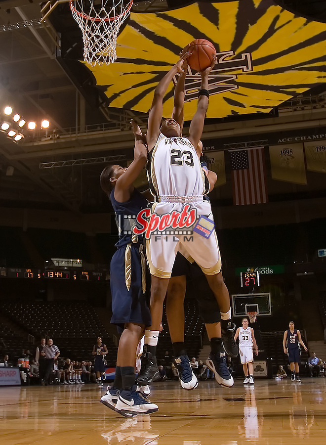 Secily Ray #23 of the Wake Forest Demon Deacons pulls down a rebound during first half action versus the East Tennessee State Buccaneers at the LJVM Coliseum December 28, 2008 in Winston-Salem, NC.  The Demon Deacons defeated the Buccaneers 72-66. (Photo by Brian Westerholt / Sports On Film)