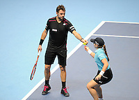 Stan Wawrinka (SUI) picks up a piece of confetti that fell from the ceiling and hands it to a ball girl during Day Two of the Barclays ATP World Tour Finals 2015 played at The O2, London on November 16th 2015