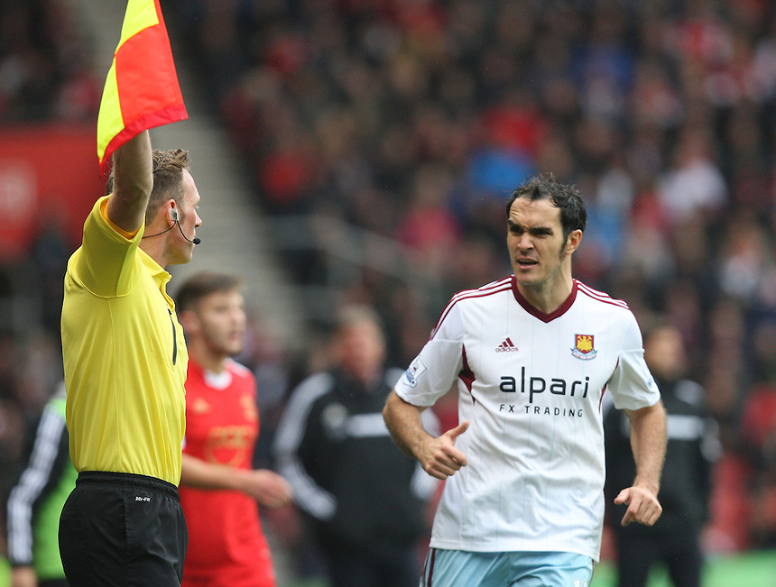 West Ham United's Joey O'Brien having with the Linesman<br /> <br /> Photo by Kieran Galvin/CameraSport<br /> <br /> Football - Barclays Premiership - Southampton v West Ham United - Sunday 15th September 2013 -  St Mary's Stadium - Southampton<br /> <br /> &copy; CameraSport - 43 Linden Ave. Countesthorpe. Leicester. England. LE8 5PG - Tel: +44 (0) 116 277 4147 - admin@camerasport.com - www.camerasport.com