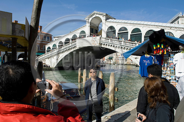 Venice-Italy - March 28, 2010 -- Rialto Bridge over Grand Canal / Canal Grande (not: Canale Grande) - an attraction for all tourists -- tourism, architecture, photography, people -- Photo: Horst Wagner / eup-images